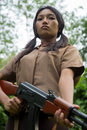Asian soldier woman holding machine gun Stock Photography
