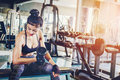 Asian sports woman doing exercises with dumbbell weights in gym Royalty Free Stock Photo