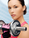 Asian sporty woman with heavy dumbbell Royalty Free Stock Photo