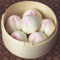Asian steamed peach buns Stock Photos