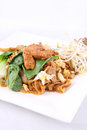 Asian stir fried flat rice noodles. Pad se ew with chicken. Royalty Free Stock Images