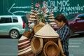 Asian straw hat seller
