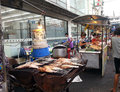Asian street market selling food on the side of in thailand Royalty Free Stock Photos
