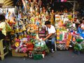 Asian street vendor selling different religious items outside of quiapo church in quiapo, manila, philippines in asia
