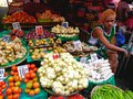 Asian street vendor selling fruits and vegetable in quiapo manila philippines in asia a photo an different kinds of Royalty Free Stock Image