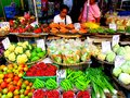 Asian street vendor selling fruits and vegetable in quiapo manila philippines in asia a photo an different kinds of Royalty Free Stock Photography