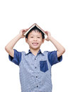 Asian student with a book on his head smiling isolated over white Stock Photos