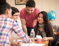 Asian student studying with colleagues in classroom Royalty Free Stock Photo