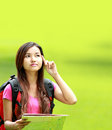 Asian student thinking something in the park portrait of beautiful wearing backpack Stock Photo