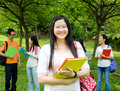 Asian students happy in the park Royalty Free Stock Image