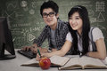 Asian students studying in class young together Royalty Free Stock Photography