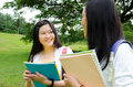 Asian students university having conversation Stock Image