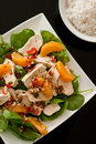 Asian-style chicken salad with bowl of rice Royalty Free Stock Photos