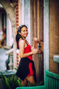 Asian summer woman leaning against door Royalty Free Stock Photo