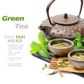 Asian tea set with dried green tea and fresh mint Stock Photos