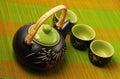 Asian tea set served on a bamboo place mat Royalty Free Stock Photos