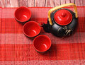 Asian tea set served on a bamboo place mat Royalty Free Stock Images