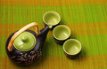 Asian tea set served on a bamboo place mat Royalty Free Stock Image