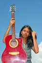 Asian teen with guitar Royalty Free Stock Photo