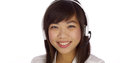 Asian telemarketer looking at camera and smiling Royalty Free Stock Image