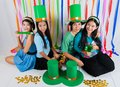 Asian thai girls hold big green hat st patrick s day act happiness celebating feeling Royalty Free Stock Photography