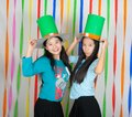 Asian thai girls hold big green hat st patrick s day act happiness celebrating feeling Royalty Free Stock Image