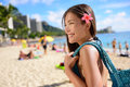 Asian tourist woman on waikiki beach hawaii usa vacation in pretty girl holding bag walking famous touristic area in Royalty Free Stock Images