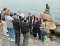 Asian tourists check travel photos at the viewpoint in Monaco.