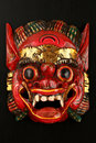 Asian traditional wooden red painted demon mask Royalty Free Stock Photo