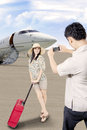 Asian traveler arrive at airport with her husband took picture of her Royalty Free Stock Image