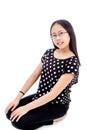 Asian Tween Girl in kneeling Pose Royalty Free Stock Photo