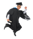 Asian university student in graduation gown full body excited male jumping high or running isolated on white background Royalty Free Stock Photo