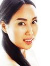 Asian woman beauty face closeup portrait. Beautiful attractive mixed race Chinese Asian Caucasian female model with Royalty Free Stock Photo