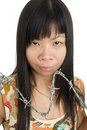 Asian woman behind barbed wire Royalty Free Stock Images