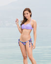 Asian woman in bikini, smiling Royalty Free Stock Photo