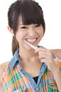 Asian woman brushing teeth Royalty Free Stock Photo