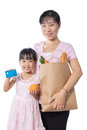 Asian Woman and daughter buying groceries with credit card Royalty Free Stock Photo