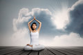 Asian woman doing yoga exercise under blue sky Royalty Free Stock Photo