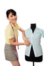Asian woman dressmaker young adjusting clothes on tailoring mannequin Stock Image