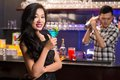 Asian woman with a drink smiling women in the bar Stock Photo