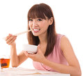 Asian woman eat rice portrait of isolated on white background female model Stock Images