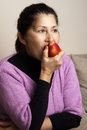Asian woman eating an apple Royalty Free Stock Photo