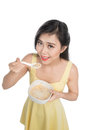 Asian woman eating bowl of cereal or muesli for breakfast Royalty Free Stock Photo