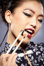 Asian woman eating sushi young beautiful Royalty Free Stock Images