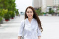 Asian woman face smile walking on city street Royalty Free Stock Photo