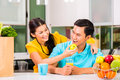 Asian woman feeding boyfriend with apple young couple handsome women after grocery shopping Stock Images