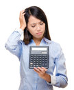 Asian woman feel sad and trouble with calculator isolated on white Royalty Free Stock Photography