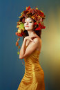 Asian woman in golden dress Royalty Free Stock Photo