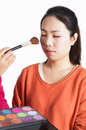 Asian woman having blush applied by a beautician Royalty Free Stock Image