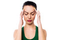 Asian woman having headache applying gentle pressure on temple of her head Stock Images